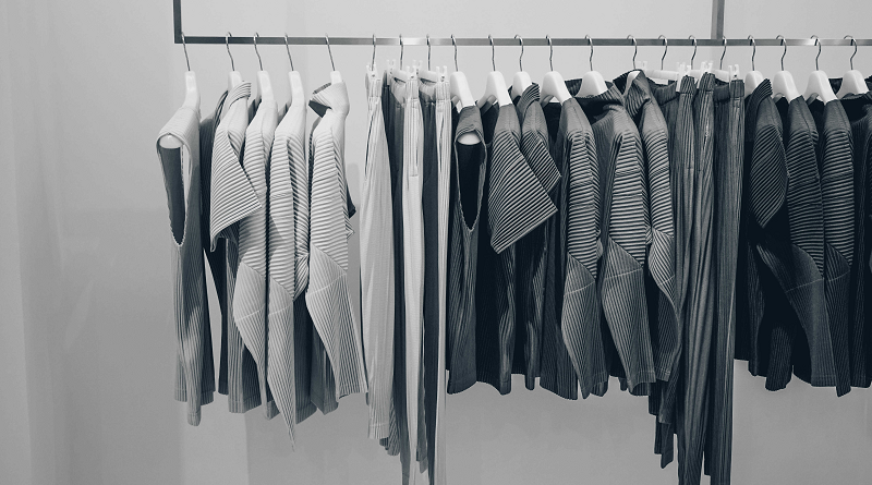 A rack of very gray boring looking clothes